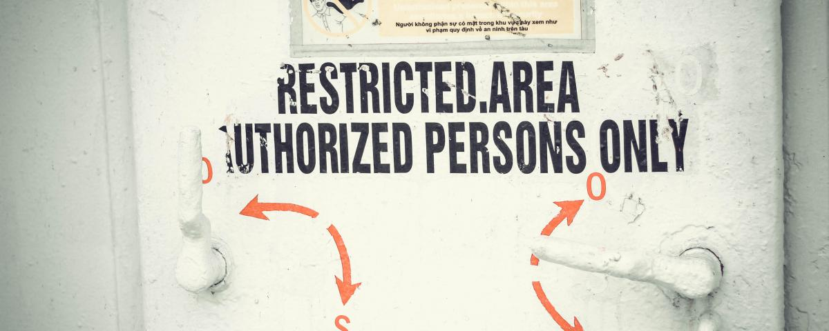 Image of a door with a sign reading: Restricted area, Authorized Persons Only