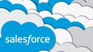 Salesforce logo, a blue cloud with white type, in front of multiple clouds overlapping in the background