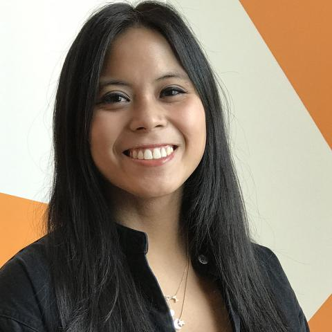 headshot of Isabelle Tan, UX Designer