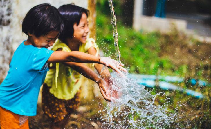 Image of children playing with water